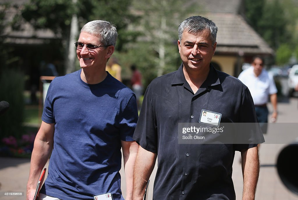 <a gi-track='captionPersonalityLinkClicked' href=/galleries/search?phrase=Tim+Cook+-+Business+Executive&family=editorial&specificpeople=8084206 ng-click='$event.stopPropagation()'>Tim Cook</a> (L), chief executive officer of Apple Inc. and Eddie Cue, senior vice president of internet software and services at Apple Inc., attend the Allen & Company Sun Valley Conference on July 9, 2014 in Sun Valley, Idaho. Many of the worlds wealthiest and most powerful business people from media, finance, and technology attend the annual week-long conference which is in its 32nd year.