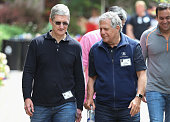 Tim Cook chief executive officer of Apple Inc and Leslie Moonves president and chief executive officer of CBS Corp talk at the Allen Company Sun...