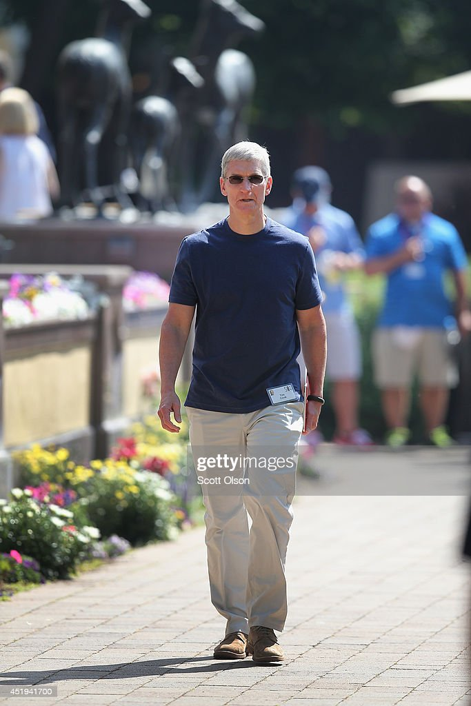 <a gi-track='captionPersonalityLinkClicked' href=/galleries/search?phrase=Tim+Cook+-+Business+Executive&family=editorial&specificpeople=8084206 ng-click='$event.stopPropagation()'>Tim Cook</a>, chief executive officer of Apple Inc., attends the Allen & Company Sun Valley Conference on July 9, 2014 in Sun Valley, Idaho. Many of the worlds wealthiest and most powerful business people from media, finance, and technology attend the annual week-long conference which is in its 32nd year.