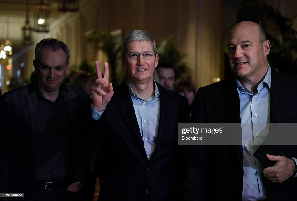 Tim Cook chief executive officer of Apple Inc center arrives to speak with Gary Cohn president and chief operating officer of Goldman Sachs Group Inc...