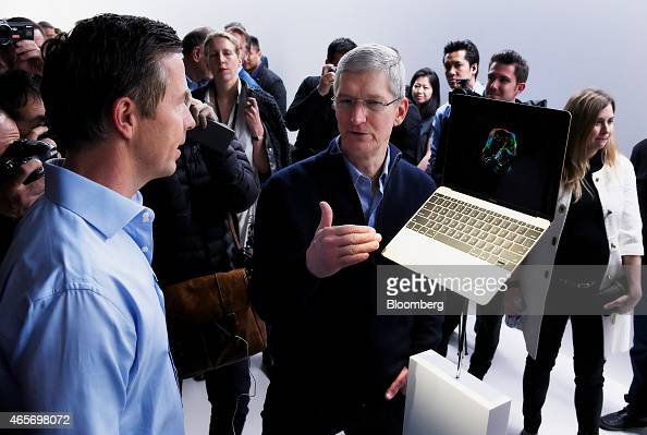 Tim Cook chief executive officer of Apple Inc center speaks about the new gold edition Macbook laptop during the Apple Inc Spring Forward event in...