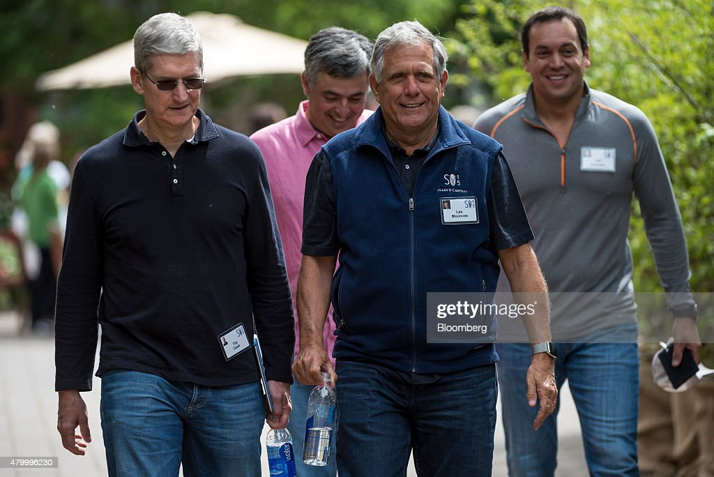 Tim Cook chief executive officer of Apple Inc front left Leslie 'Les' Moonves president and chief executive officer of CBS Corp front right Eddy Cue...