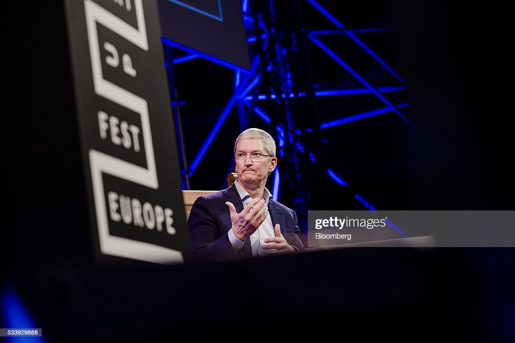 <a gi-track='captionPersonalityLinkClicked' href=/galleries/search?phrase=Tim+Cook+-+Business+Executive&family=editorial&specificpeople=8084206 ng-click='$event.stopPropagation()'>Tim Cook</a>, chief executive officer of Apple Inc., gestures during the opening of 'Startup Fest', a five-day conference to showcase Dutch innovation, in Amsterdam, Netherlands, on Tuesday, May 24, 2016. The Digital City Index for 2015 ranked Amsterdam Europe's second-best city, behind London, for tech startups. Photographer: Marlene Awaad/Bloomberg via Getty Images