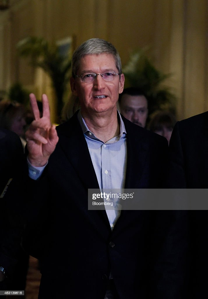 <a gi-track='captionPersonalityLinkClicked' href=/galleries/search?phrase=Tim+Cook+-+Business+Executive&family=editorial&specificpeople=8084206 ng-click='$event.stopPropagation()'>Tim Cook</a>, chief executive officer of Apple Inc., gestures while arriving to speak at the Goldman Sachs Technology And Internet Conference in San Francisco, California, U.S., on Tuesday, Feb. 10, 2015. Apple Inc., which began flirting with a record valuation of $700 billion during midday trading in November, ended the day at $710.7 billion, marking the first time a U.S. company has reached that milestone. Shares rose 1.9 percent to $122.02 at the close in New York. Photographer: David Paul Morris/Bloomberg via Getty Images