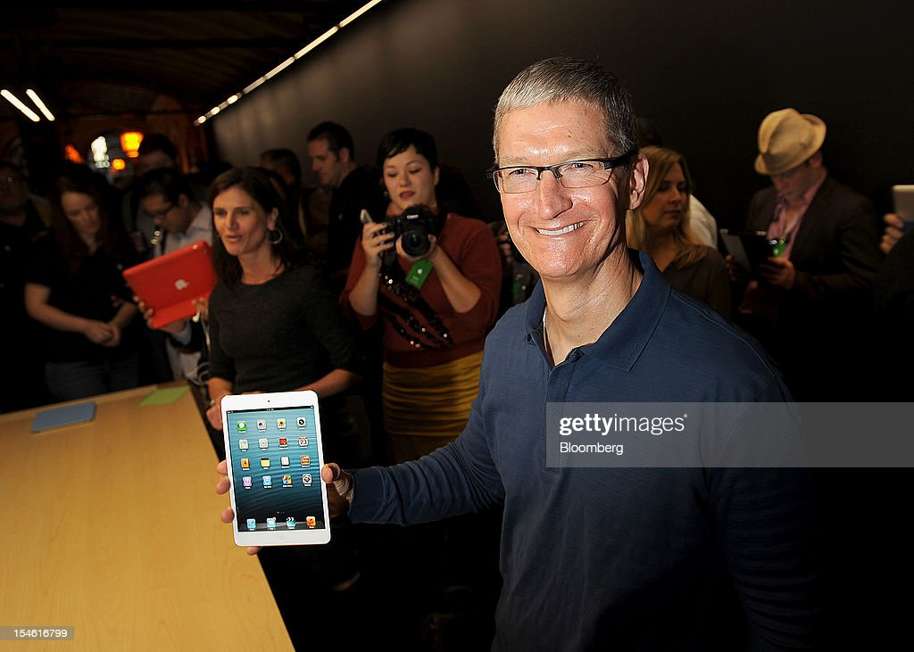 Tim Cook, chief executive officer of Apple Inc., holds an iPad Mini during an event in San Jose, California, U.S., on Tuesday, Oct. 23, 2012. Apple Inc. introduced a smaller version of the iPad designed to keep customers from buying low-cost tablets from competitors Microsoft Corp., Amazon.com Inc. and Google Inc. Photographer: Noah Berger/Bloomberg via Getty Images