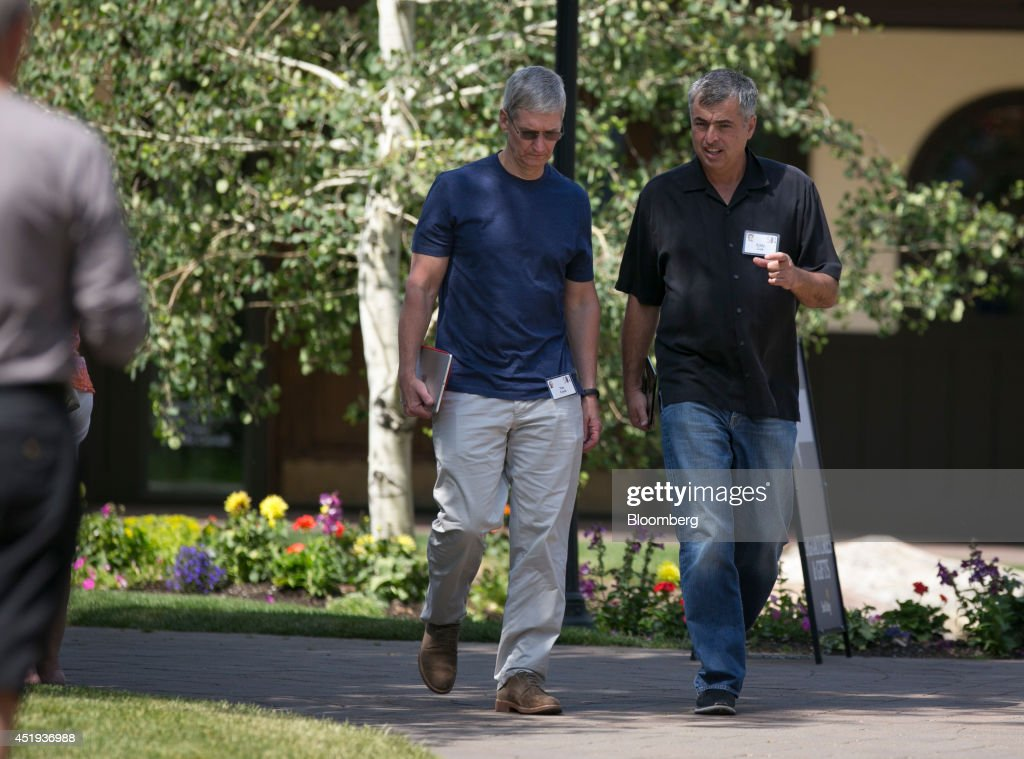 Tim Cook chief executive officer of Apple Inc left and Eddy Cue senior vice president of internet software and services at Apple Inc walk the grounds...