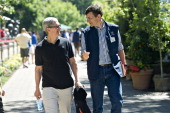 Tim Cook chief executive officer of Apple Inc left walks with Vittorio Colao chief executive officer of Vodafone Group Plc during the Allen Co Media...