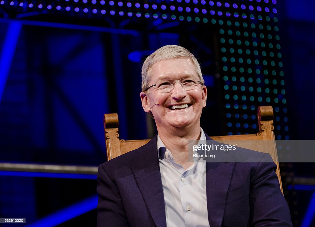 <a gi-track='captionPersonalityLinkClicked' href=/galleries/search?phrase=Tim+Cook+-+Business+Executive&family=editorial&specificpeople=8084206 ng-click='$event.stopPropagation()'>Tim Cook</a>, chief executive officer of Apple Inc., reacts as he delivers a speech during the opening of 'Startup Fest', a five-day conference to showcase Dutch innovation, in Amsterdam, Netherlands, on Tuesday, May 24, 2016. The Digital City Index for 2015 ranked Amsterdam Europe's second-best city, behind London, for tech startups. Photographer: Marlene Awaad/Bloomberg via Getty Images