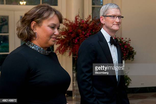 Tim Cook chief executive officer of Apple Inc right and Lisa Jackson former administrator of the US Environmental Protection Agency and vice...
