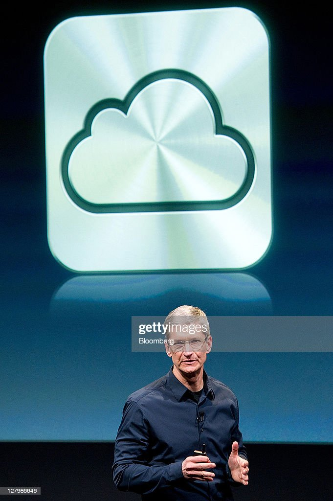 Tim Cook, chief executive officer of Apple Inc., speaks about new features of the iCloud service during an event at the company's headquarters in Cupertino, California, U.S., on Tuesday, Oct. 4, 2011. Apple Inc., in its first product unveiling since Steve Jobs resigned as chief executive officer, introduced a faster iPhone with voice features and a higher-resolution camera to help it vie with Google Inc.'s Android. Photographer: David Paul Morris/Bloomberg via Getty Images