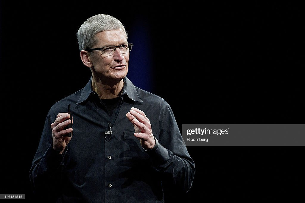 Tim Cook, chief executive officer of Apple Inc., speaks at the Apple Worldwide Developers Conference in San Francisco, California, U.S., on Monday, June 11, 2012. Apple Inc. is releasing a fresh lineup of computers and software tools to woo consumers and keep developers making applications amid accelerating rivalry from Google Inc., Microsoft Corp. and, now, Facebook Inc. Photographer: David Paul Morris/Bloomberg via Getty Images