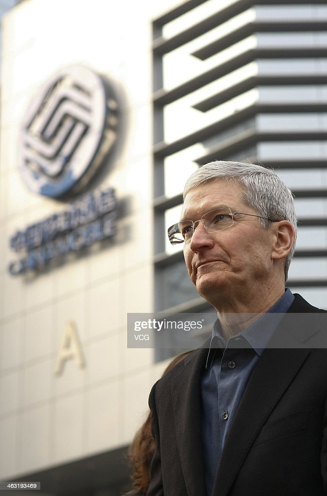 Tim Cook, Chief Executive Officer of Apple Inc., visits a China Mobile shop to celebrate the launch of iPhone 5S and iPhone 5C on China Mobile's fourth generation (4G) network on January 17, 2014 in Beijing, China. Apple Inc. and China Mobile Limited, the world's largest carrier with over 760 million subscribers, signed a deal on December 23, 2013 after six years of negotiations.