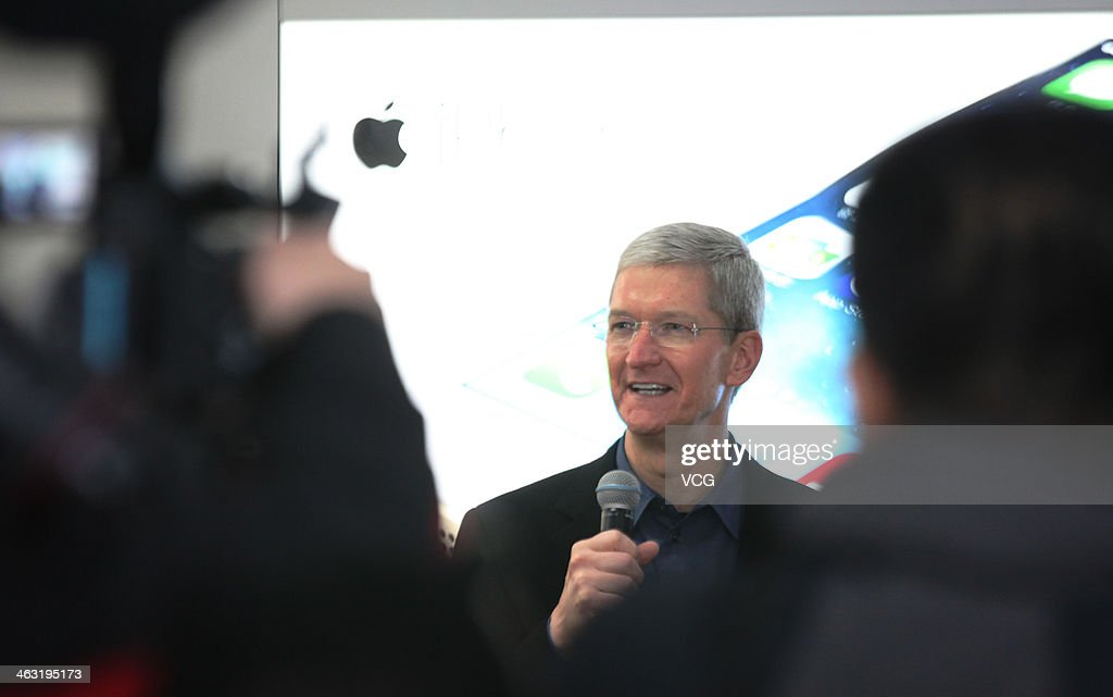 <a gi-track='captionPersonalityLinkClicked' href=/galleries/search?phrase=Tim+Cook+-+Business+Executive&family=editorial&specificpeople=8084206 ng-click='$event.stopPropagation()'>Tim Cook</a>, Chief Executive Officer of Apple Inc., visits a China Mobile shop to celebrate the launch of iPhone 5S and iPhone 5C on China Mobile's fourth generation (4G) network on January 17, 2014 in Beijing, China. Apple Inc. and China Mobile Limited, the world's largest carrier with over 760 million subscribers, signed a deal on December 23, 2013 after six years of negotiations.