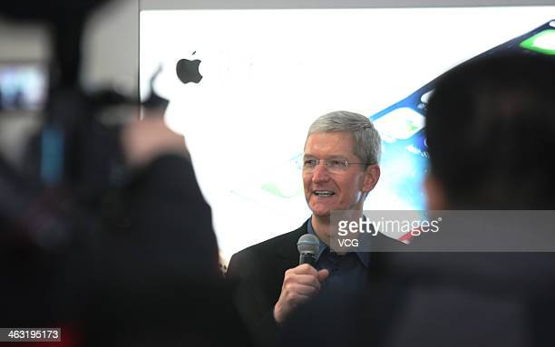 Tim Cook Chief Executive Officer of Apple Inc visits a China Mobile shop to celebrate the launch of iPhone 5S and iPhone 5C on China Mobile's fourth...