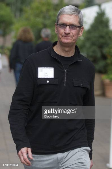 Tim Cook chief executive officer of Apple Inc walks outside during the Allen Co Media and Technology Conference in Sun Valley Idaho US on Thursday...