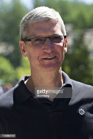 Tim Cook chief executive officer of Apple Inc walks outside during the Allen Co Media and Technology Conference in Sun Valley Idaho US on Friday July...