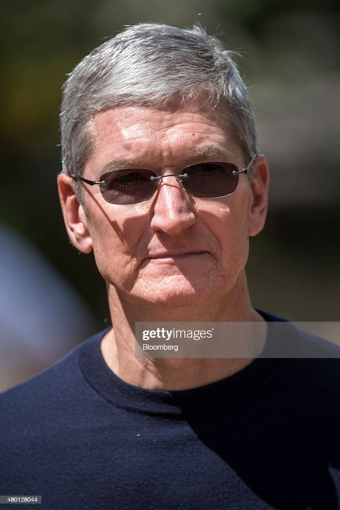 Tim Cook chief executive officer of Apple Inc walks the grounds after a morning session during the Allen Co Media and Technology Conference in Sun...