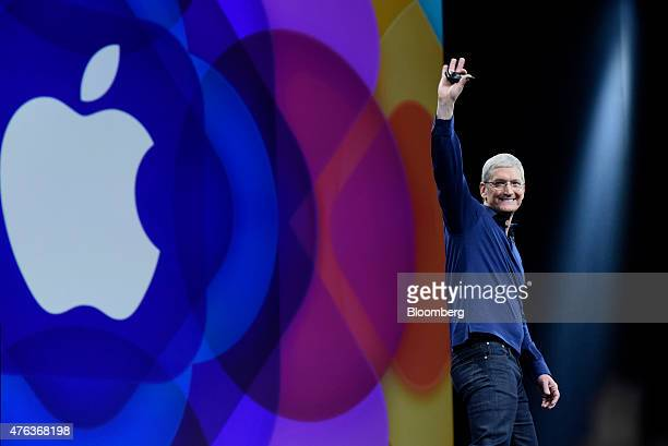 Tim Cook chief executive officer of Apple Inc waves before speaking during the Apple World Wide Developers Conference in San Francisco California US...