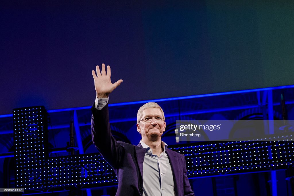 <a gi-track='captionPersonalityLinkClicked' href=/galleries/search?phrase=Tim+Cook+-+Business+Executive&family=editorial&specificpeople=8084206 ng-click='$event.stopPropagation()'>Tim Cook</a>, chief executive officer of Apple Inc., waves to the audience during the opening of 'Startup Fest', a five-day conference to showcase Dutch innovation, in Amsterdam, Netherlands, on Tuesday, May 24, 2016. The Digital City Index for 2015 ranked Amsterdam Europe's second-best city, behind London, for tech startups. Photographer: Marlene Awaad/Bloomberg via Getty Images
