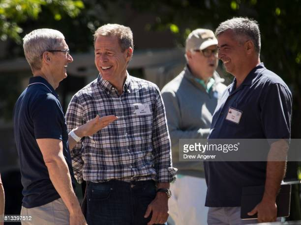 Tim Cook chief executive officer of Apple Jeff Bewkes chief executive officer of Time Warner and Eddy Cue senior vice president of internet software...