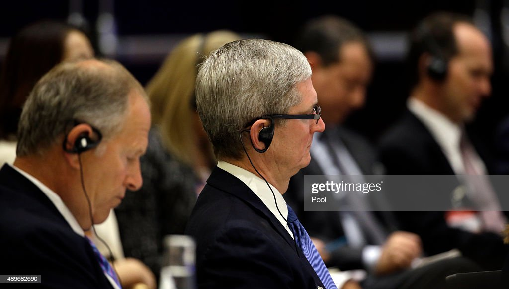Tim Cook of Apple and David Cote of Honeywell listen as Chinese President Xi Jinping speaks at a USChina business roundtable comprised of US and...