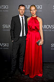 Tim Coppens and Misha Nonoo Julia pose for a picture on the 'black' carpet of the grand reopening of the Swarovski Crystal Worlds on April 28 2015 in...