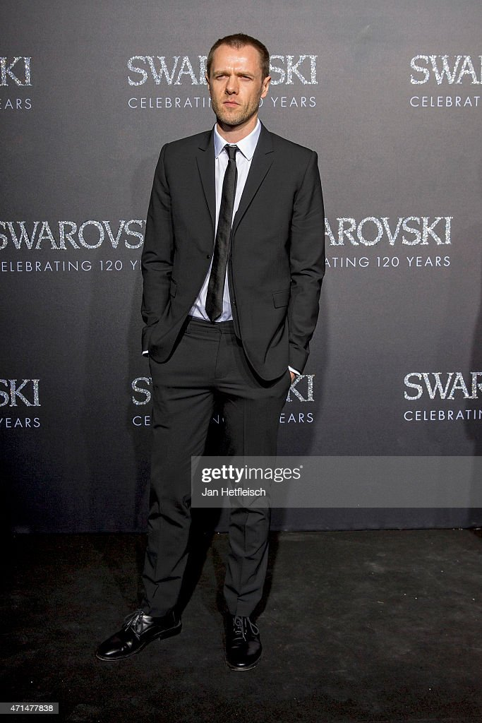 Tim Coppens poses for a picture on the 'black' carpet of the grand reopening of the Swarovski Crystal Worlds on April 28 2015 in Wattens Austria The...
