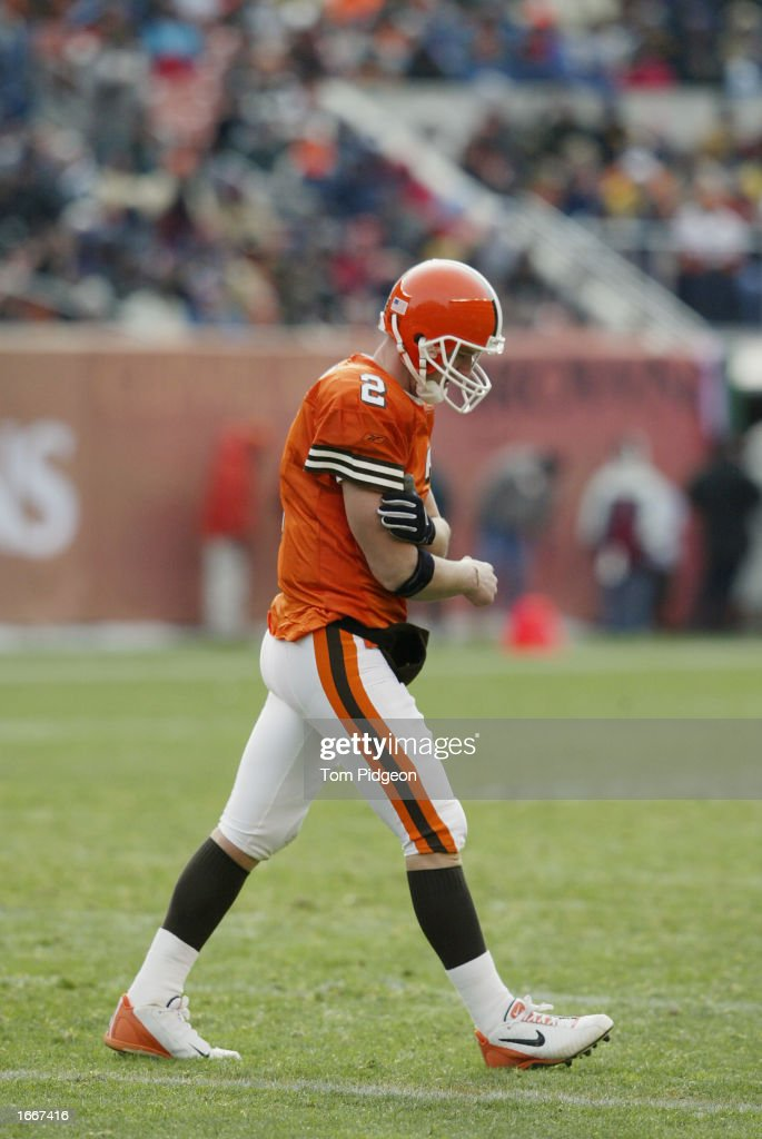 Tim Couch #2 of the Cleveland Browns walks to the sidelines holding his arm after being sacked by the Carolina Panthers on December 1, 2002 at Browns Stadium in Cleveland, Ohio. Carolina won the game 13-6.