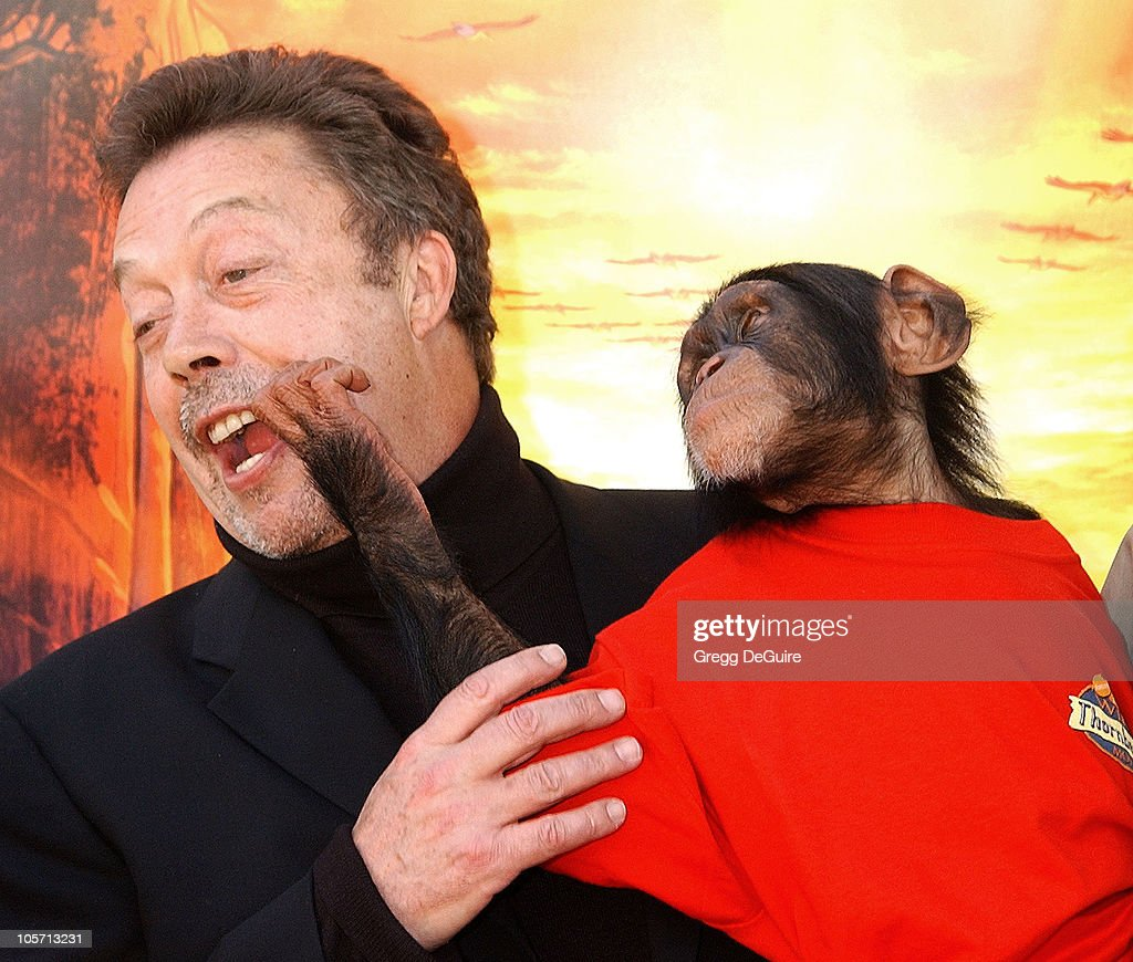 Tim Curry & Jake the Monkey during 'The Wild Thornberrys Movie' Premiere at Cinerama Dome in Hollywood, California, United States.