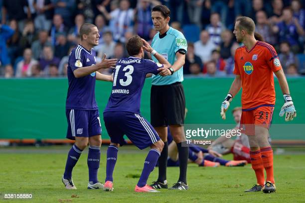 Tim Danneberg of Osnabrueck a speak with Deniz Aytekin during the DFB Cup match between VfL Osnabrueck and Hamburger SV at Osnatel Arena on August 13...