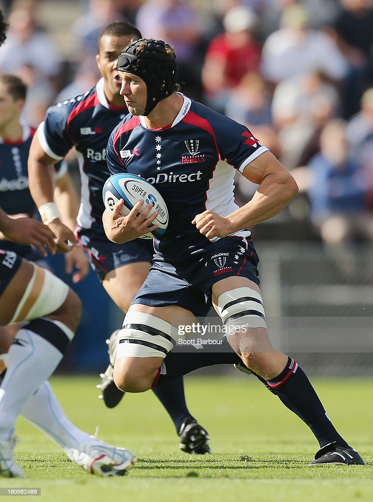 Tim Davidson of the Rebels runs with the ball during the Super Rugby trial match between the Waratahs and the Rebels at North Hobart Stadium on February 2, 2013 in Hobart, Australia.