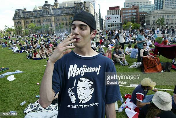 Tim Davison of Kingston Ontario smokes a giant joint during a rally in support of legalizing marijuana on June 5 2004 on Parliament Hill in Ottawa...