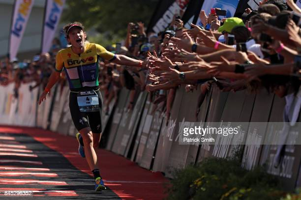 Tim Don of Great Britain celebrates as he crosses the finish line in third place in the IRONMAN 703 Men's World Championship on September 10 2017 in...