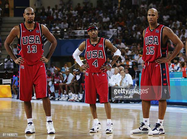 Tim Duncan Allen Iverson and Richard Jefferson of the United States look on in the men's basketball preliminary game on August 15 2004 during the...