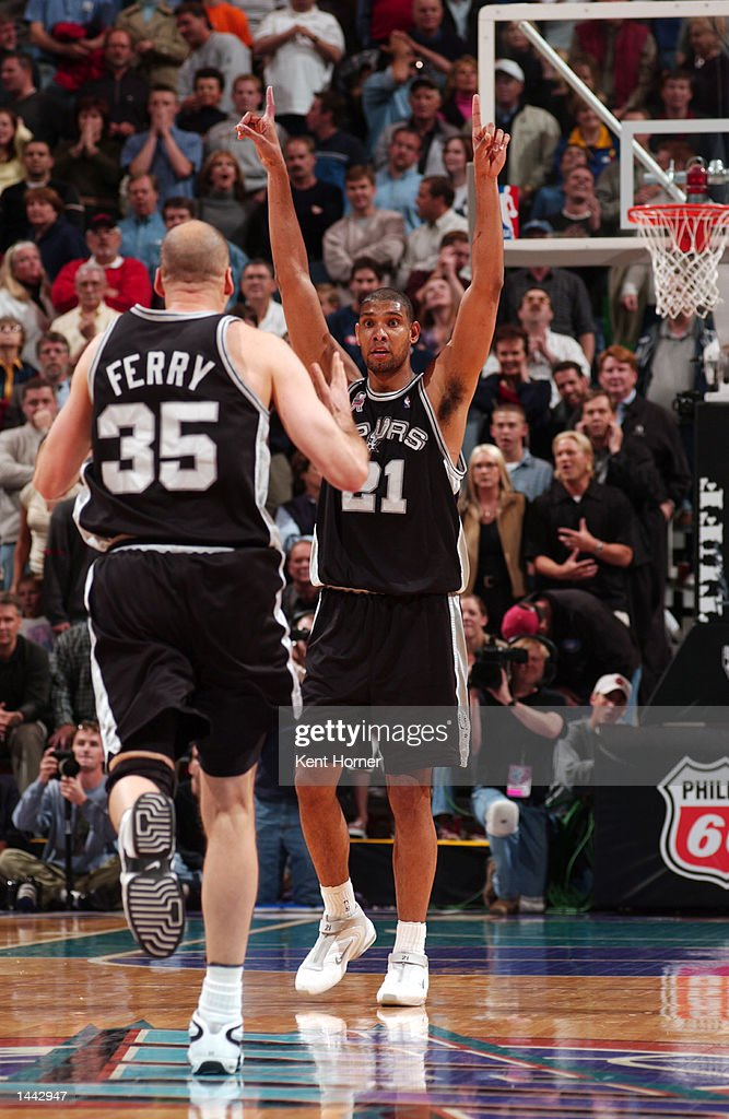 Tim Duncan and Danny Ferry of the San Antonio Spurs celebrate the game winning basket by Tony Parker with 20 seconds remaining to beat the Utah Jazz...