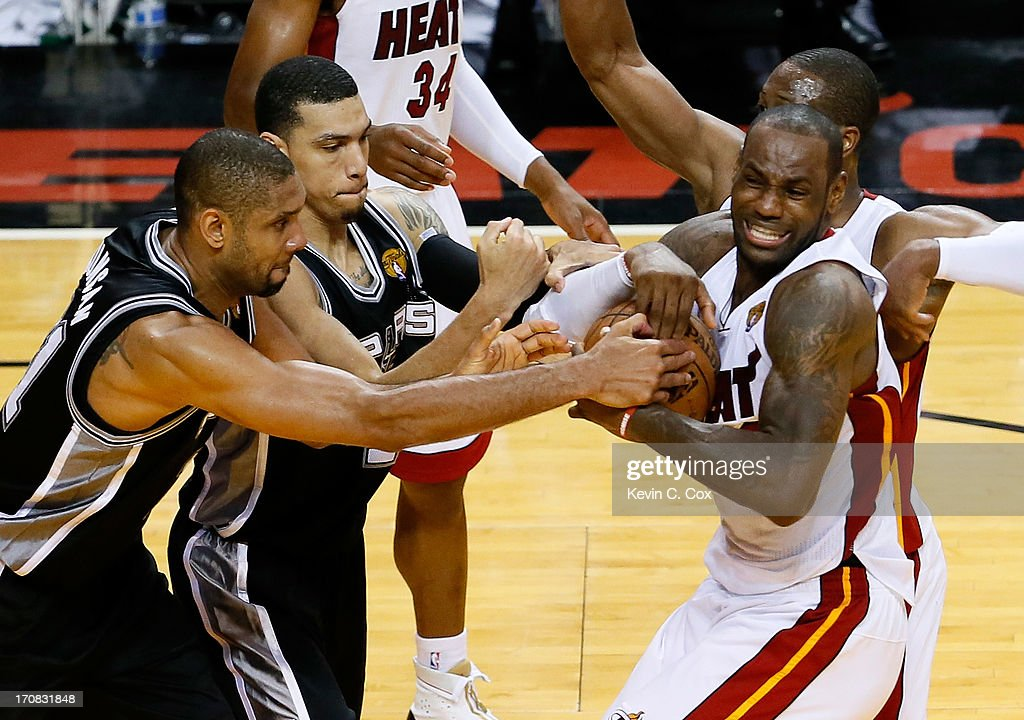 Tim Duncan #21 and Danny Green #4 of the San Antonio Spurs battle for the ball against LeBron James #6 and Dwyane Wade #3 of the Miami Heat in overtime during Game Six of the 2013 NBA Finals at AmericanAirlines Arena on June 18, 2013 in Miami, Florida.