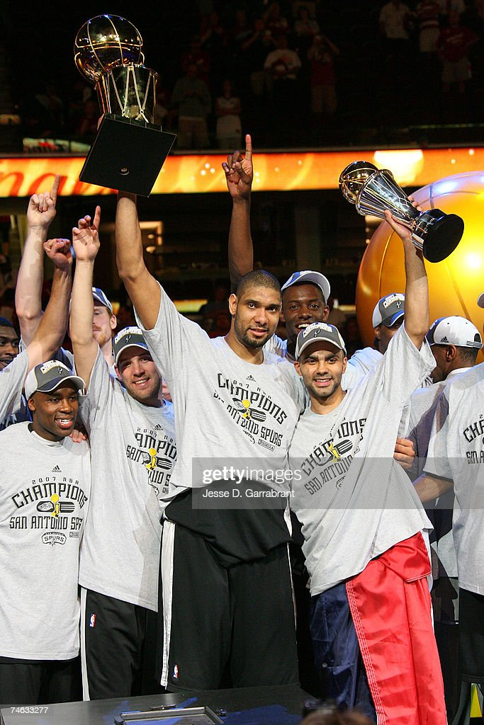 Tim Duncan #21 and Finals MVP Tony Parker #9 of the San Antonio Spurs celebrate with the Larry O'Brien Trophy and MVP Trophy after they won the NBA Championship with their 83-82 win against the Cleveland Cavaliers in Game Four of the NBA Finals at the Quicken Loans Arena on June 14, 2007 in Cleveland, Ohio.