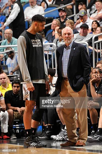 Tim Duncan and Gregg Popovich of the San Antonio Spurs speak during a game against the Orlando Magic on April 1 2015 at Amway Center in Orlando...