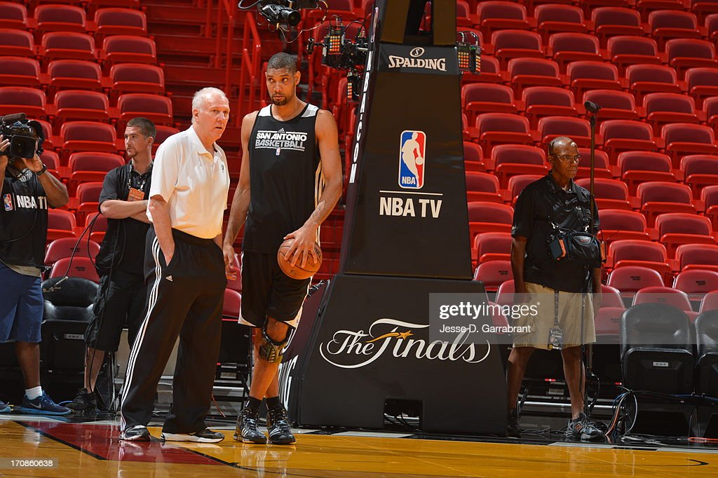 Tim Duncan and head coach Gregg Popovich of the San Antonio Spurs warm up at practice as part of the 2013 NBA Finals on June 19, 2013 at American Airlines Arena in Miami, Florida.