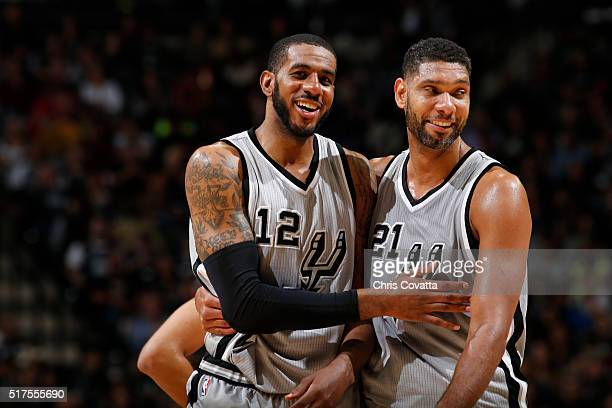 Tim Duncan and LaMarcus Aldridge of the San Antonio Spurs handles the ball against the Memphis Grizzlies on March 25 2016 at the ATT Center in San...