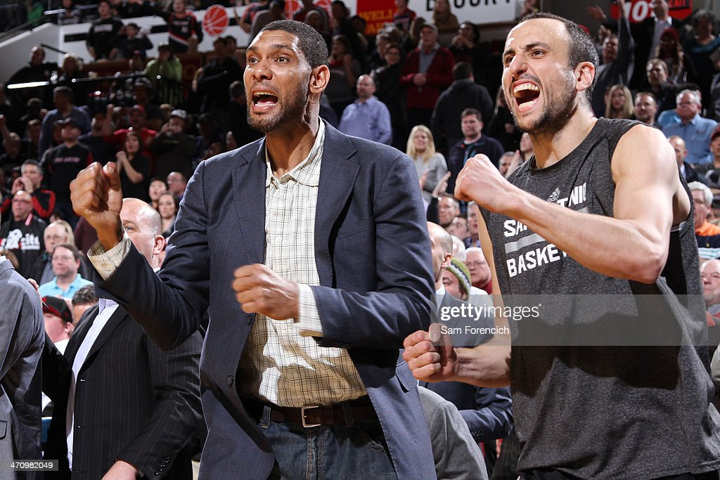 <a gi-track='captionPersonalityLinkClicked' href=/galleries/search?phrase=Tim+Duncan&family=editorial&specificpeople=201467 ng-click='$event.stopPropagation()'>Tim Duncan</a> #21 and Manu Ginobili #20 of the San Antonio Spurs react to a play on the bench against the Portland Trail Blazers on February 19, 2014 at the Moda Center Arena in Portland, Oregon.
