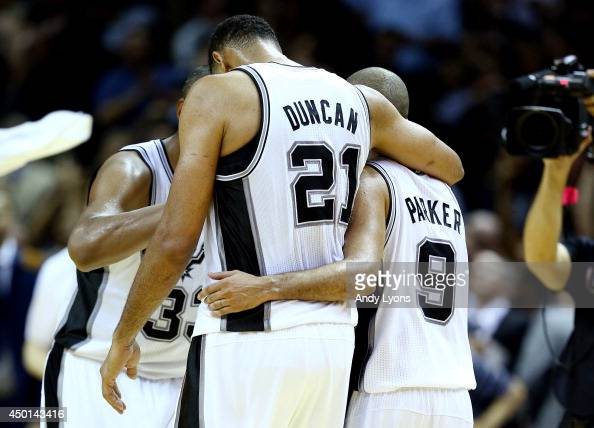 Tim Duncan and Tony Parker of the San Antonio Spurs celebrate after defeating the Miami Heat 11095 in Game One of the 2014 NBA Finals at the ATT...
