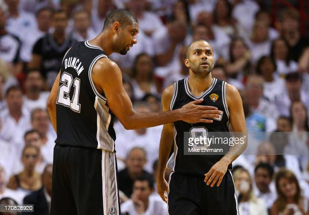 Tim Duncan and Tony Parker of the San Antonio Spurs celebrate in the third quarter while taking on the Miami Heat during Game Six of the 2013 NBA...