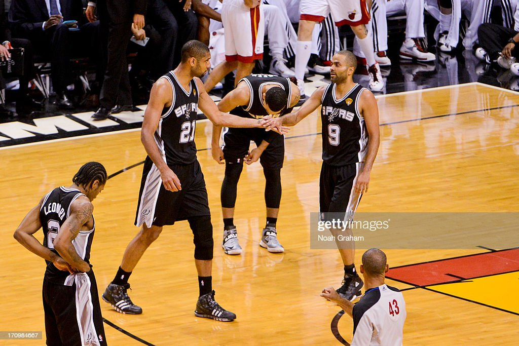 Tim Duncan #21 and Tony Parker #9 of the San Antonio Spurs celebrate while playing the Miami Heat during Game Seven of the 2013 NBA Finals on June 20, 2013 at American Airlines Arena in Miami, Florida.