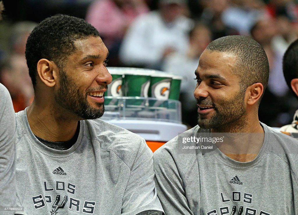 <a gi-track='captionPersonalityLinkClicked' href=/galleries/search?phrase=Tim+Duncan&family=editorial&specificpeople=201467 ng-click='$event.stopPropagation()'>Tim Duncan</a> #21 (L) and Tony Parker #9 of the San Antonio Spurs enjoy a laugh while sitting on the bench during a game against the Chicago Bulls at the United Center on March 11, 2014 in Chicago, Illinois. The Spurs defeated the Bulls 104-96.