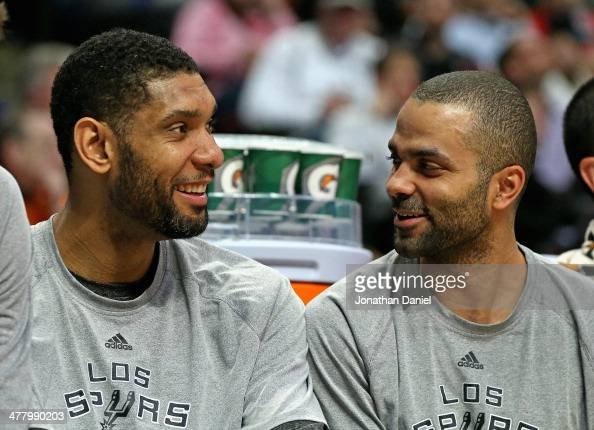Tim Duncan and Tony Parker of the San Antonio Spurs enjoy a laugh while sitting on the bench during a game against the Chicago Bulls at the United...