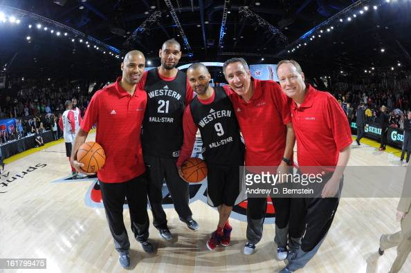 Tim Duncan and Tony Parker of the San Antonio Spurs pose with coaches during the NBA AllStar Practice in Sprint Arena at Jam Session at Jam Session...