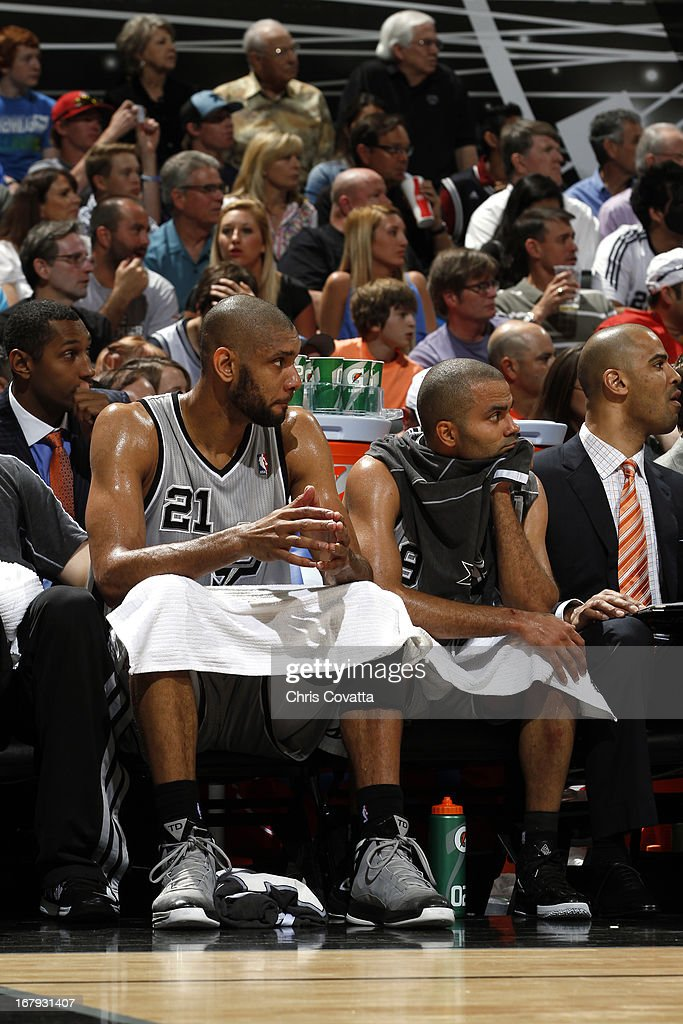 Tim Duncan #21 and Tony Parker #9 of the San Antonio Spurs sit on the bench during the game against the Los Angeles Lakers in Game One of the 2013 NBA Playoffs at the AT&T Center on April 21, 2013 in San Antonio, Texas.