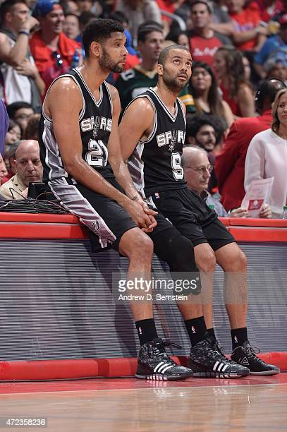 Tim Duncan and Tony Parker of the San Antonio Spurs wait to check in during a game against the Los Angeles Clippers in Game Seven of the Western...