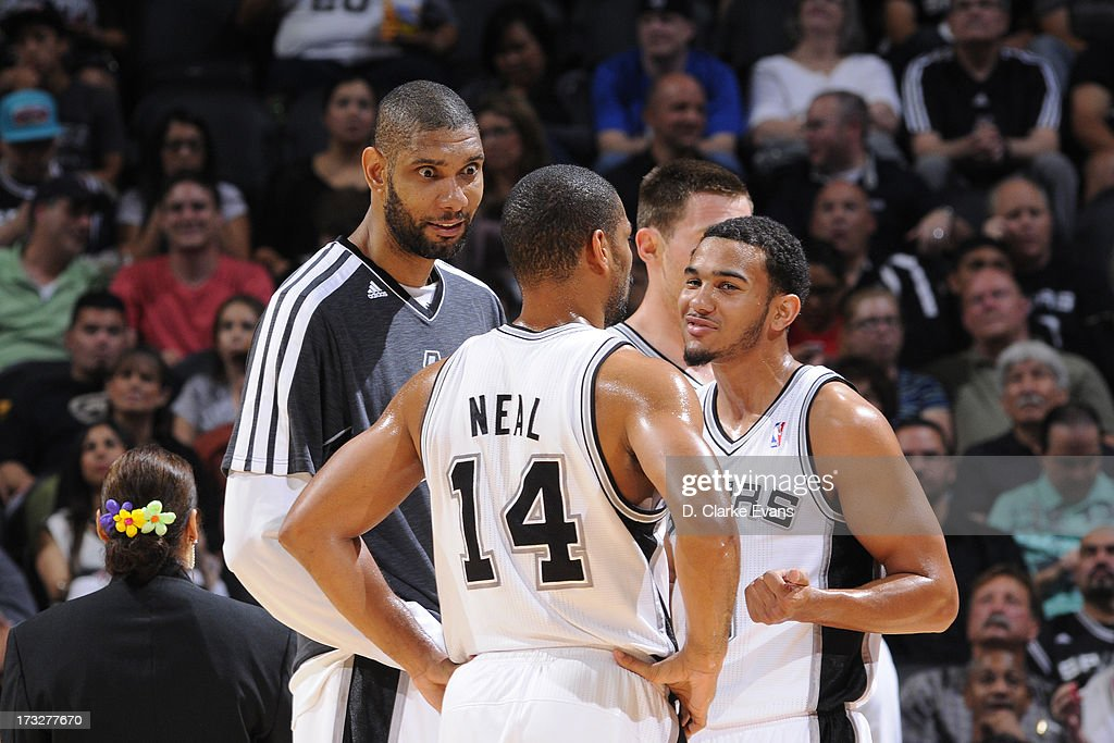 Tim Duncan #21, Gary Neal #14, and Cory Joseph #5 of the San Antonio Spurs talk during a game against the Minnesota Timberwolves on April 17, 2013 at the AT&T Center in San Antonio, Texas.